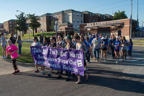 Faculty, staff and students begin their march for domestic violence awareness.