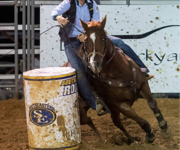 Shelby Whiting competes in barrel racing.