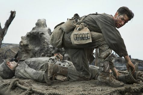 Desmond Doss(Andrew Garfield) coming to the aid of his fellow soldiers. Photo courtesy of moviehole.net.