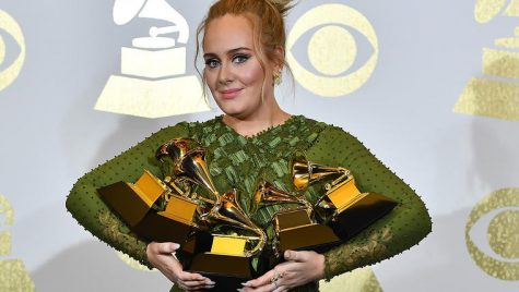 Adele poses with her five Grammy awards from the 2017 ceremony. Photo courtesy of www.mtv.co.uk.