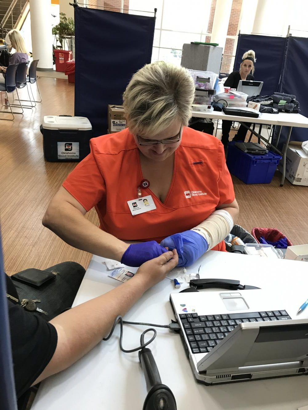 Oklahoma Blood Institute nurse prepares for an IV removal. Students lined up to give blood in hopes to help Hurricane Harvey victims.