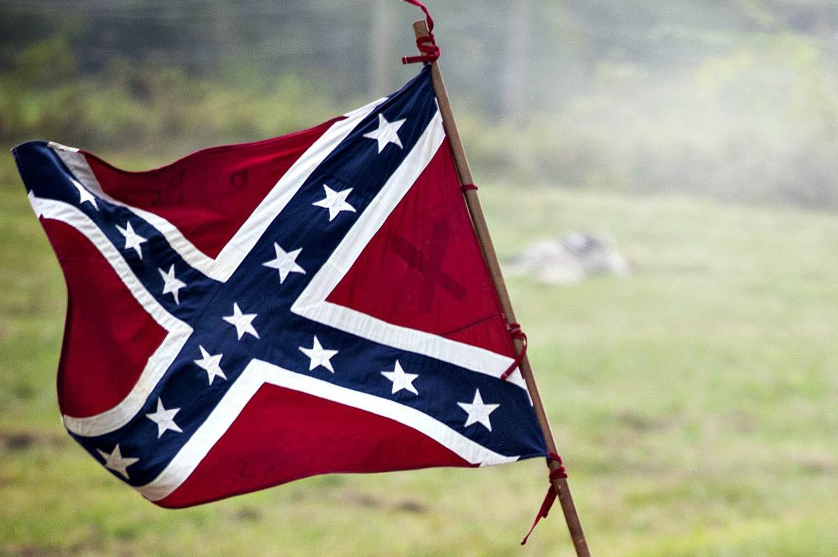 The+Confederate+flag+has+become+a+divisive+symbol+for+Americans.+For+some+it+represents+home+and+for+others+slavery+and+oppression.+Courtesy+photo+of+Bowling+Green+Daily+News.