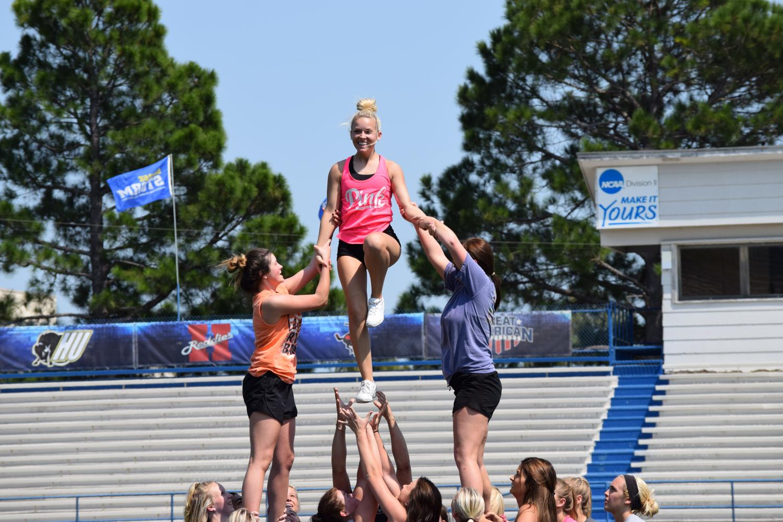 SE Cheerleaders practicing on the field