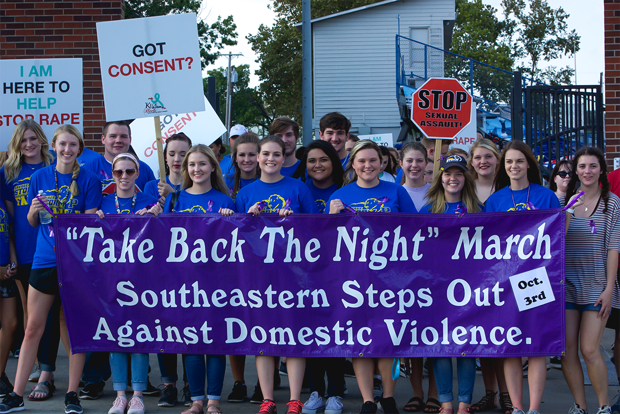 Southeastern students gather in front of the Paul Laird Field for the Take Back the Night march on Monday, Oct. 2.