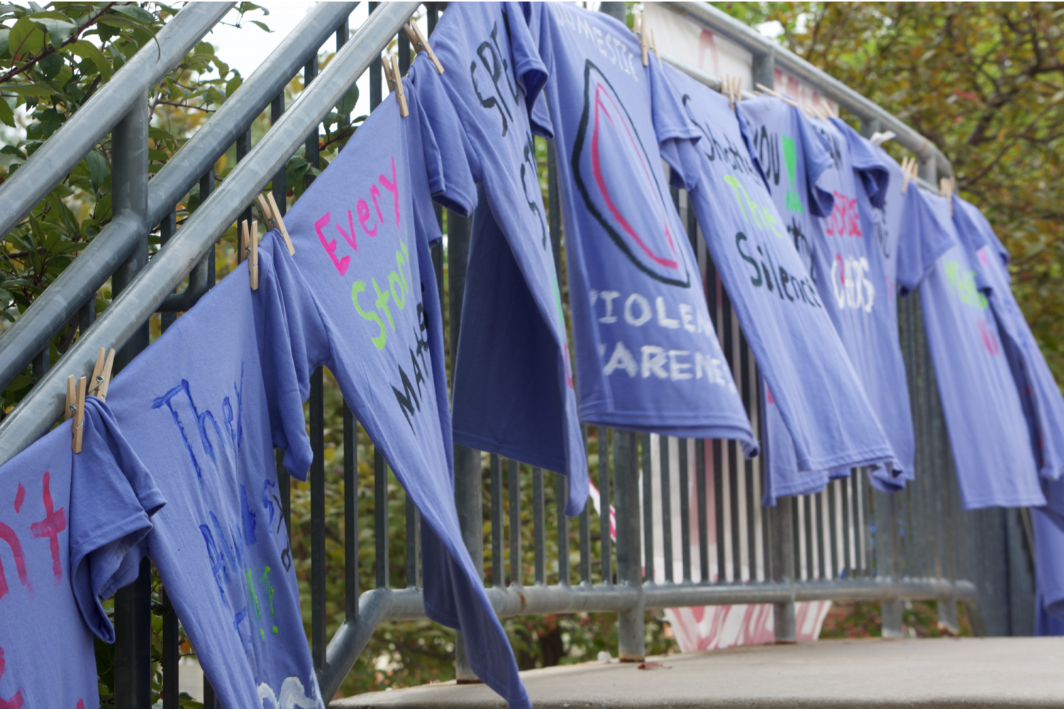 Purple shirts, representative of the color of the Domestic Violence  awareness ribbon, were hung in front of the Student Union for all to see in October 2017.