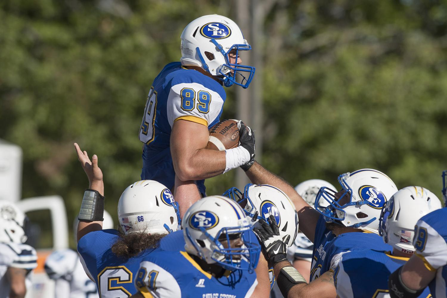 Senior receiver Codey McElroy and teammates celebrate a touchdown during Southeastern's 31-24 victory.