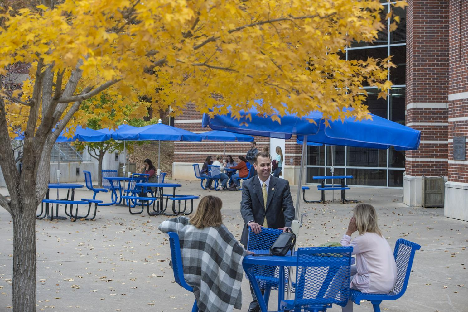 Dr. Kyle Stafford, the Vice President of University Advancement, speaks with prospective students outside of the Student Union between break out sessions.
