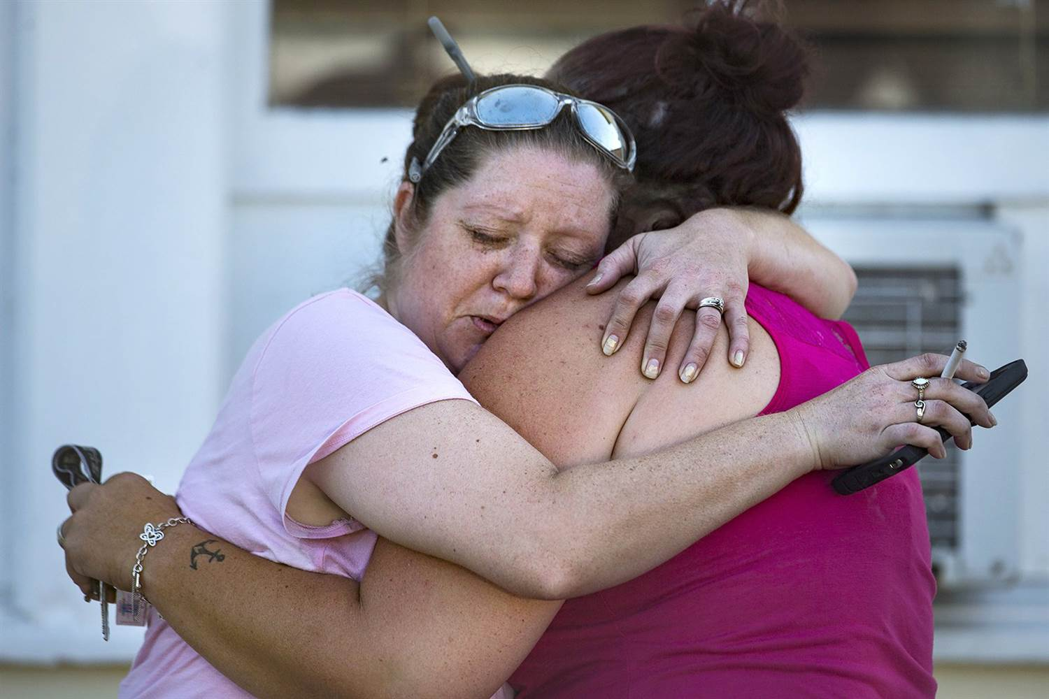 Carrie Matula embraces a woman after a fatal shooting at First Baptist Church in Sutherland Springs, Texas.