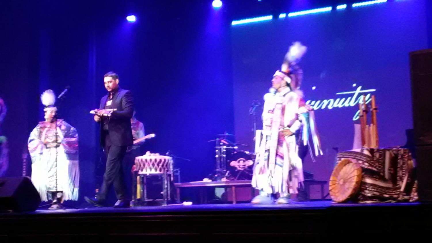 Flutist, Brad Clonch, takes center stage as native dancers perform with the group.