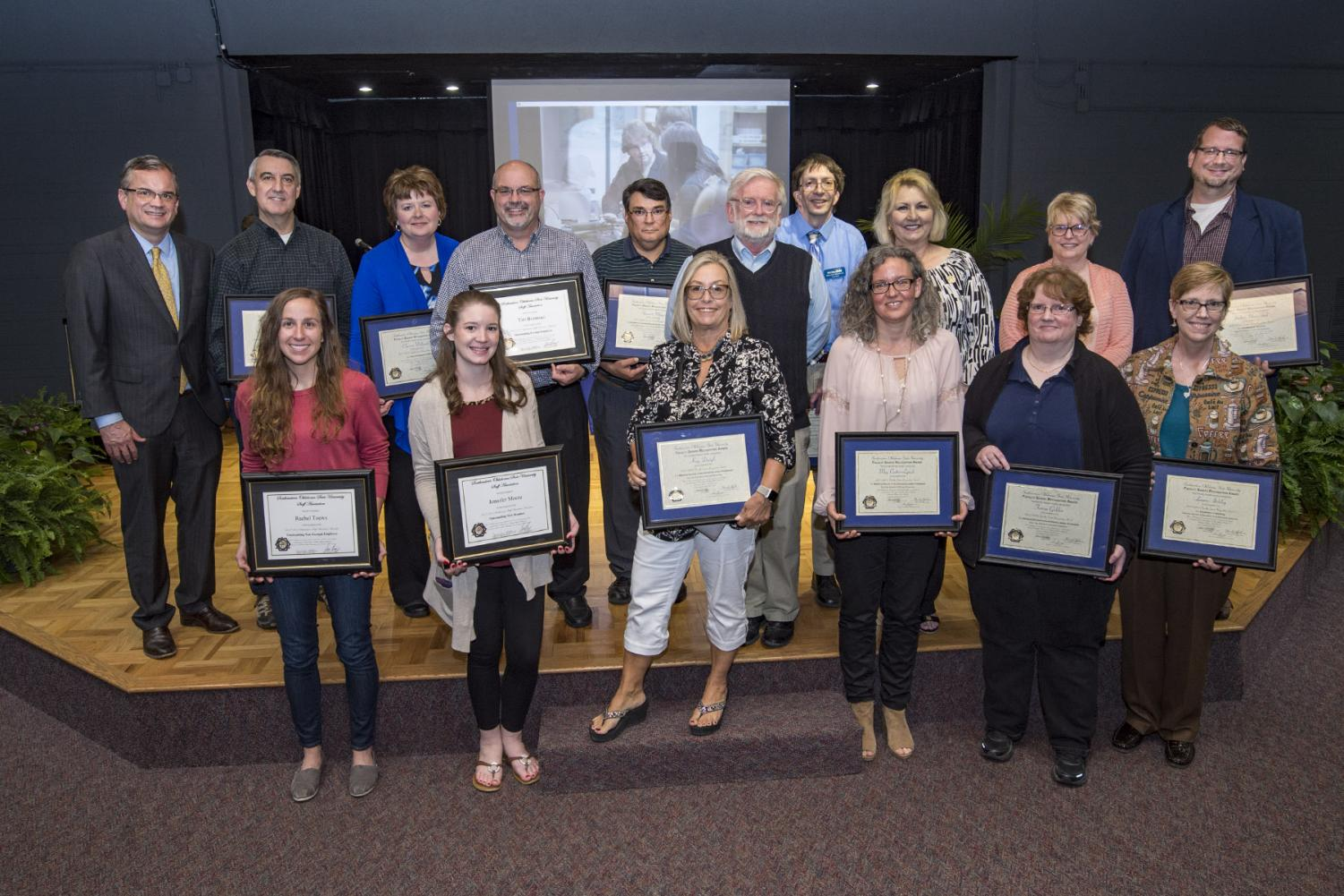Among the award winners Monday were, front row, left to right,  Rachel Toews, Jennifer Moore, Dr. Kay Daigle, Dr. Meg Cotter-Lynch, Dr. Teresa Golden, and Dr. Laura Atchley. Back row, president Sean Burrage, Dr. Doug Wood, Cherrie Wilmoth, Dr. Tim Boatmun, Dr. Stewart Mayers, Faculty Senate chair Dr. Daniel Althoff, Brandon Burnette, Kay Barber, Dr. Loide Wasmund, and Dr. Joshua Nannestad.