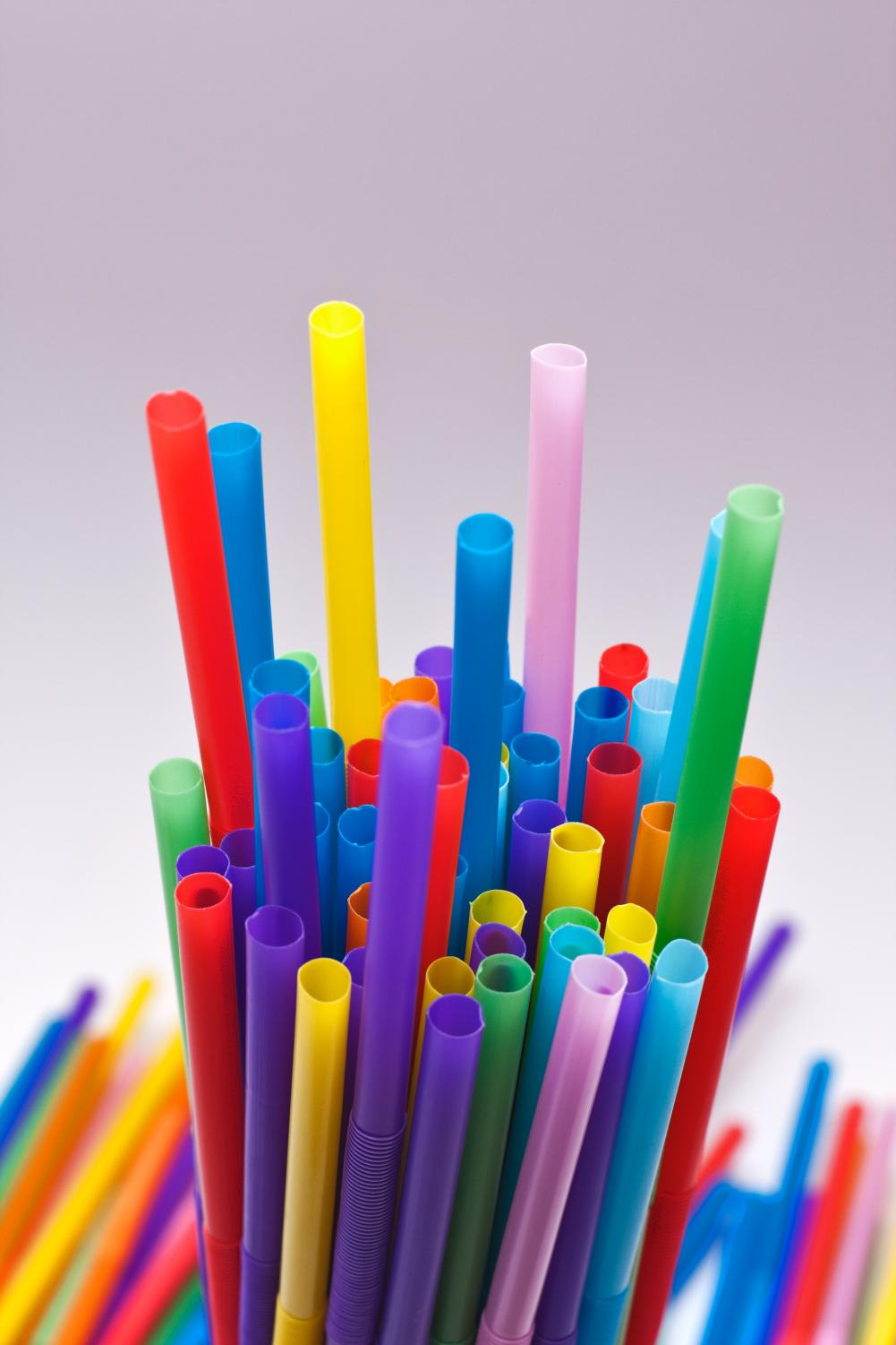 Lots of colorful plastic straws with flexible bodies stuck together in a glass. https://creativecommons.org/licenses/by/2.0/deed.en