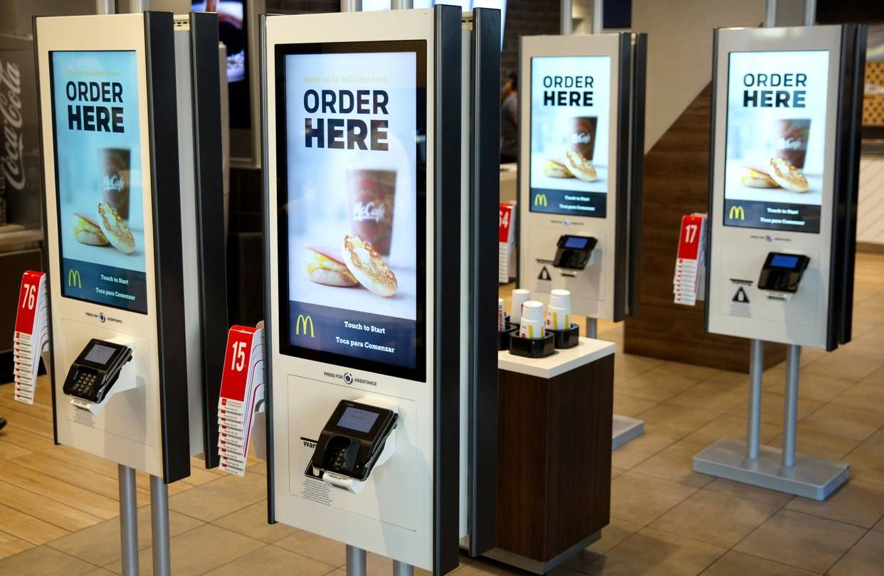 Concerns with the quality of customer service emerge as more and more chain restaurants install self-service kiosks and additional drive-thru lanes.