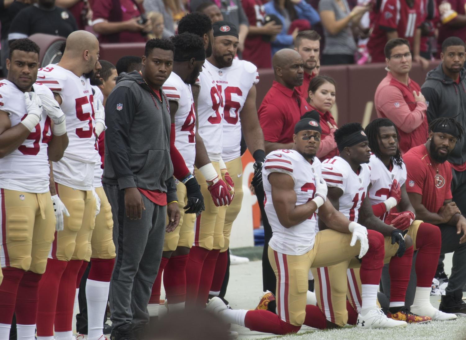 Some members of the San Francisco 49ers kneel during the National Anthem before a game against the Washington Redskins at FedEx Field https://creativecommons.org/licenses/by-sa/2.0/deed.en