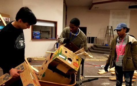 Dylan Candelora, Tay Pruitt, and Jay Carr help remove trash from the J127 building on January 21, 2019.