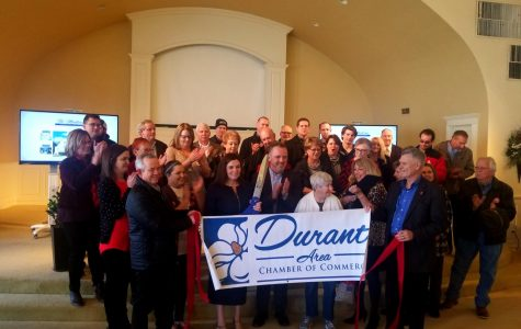 Tim and Brandy Rundel, owners of The Montery, and community members attend ribbon cutting ceremony on Feb. 7.