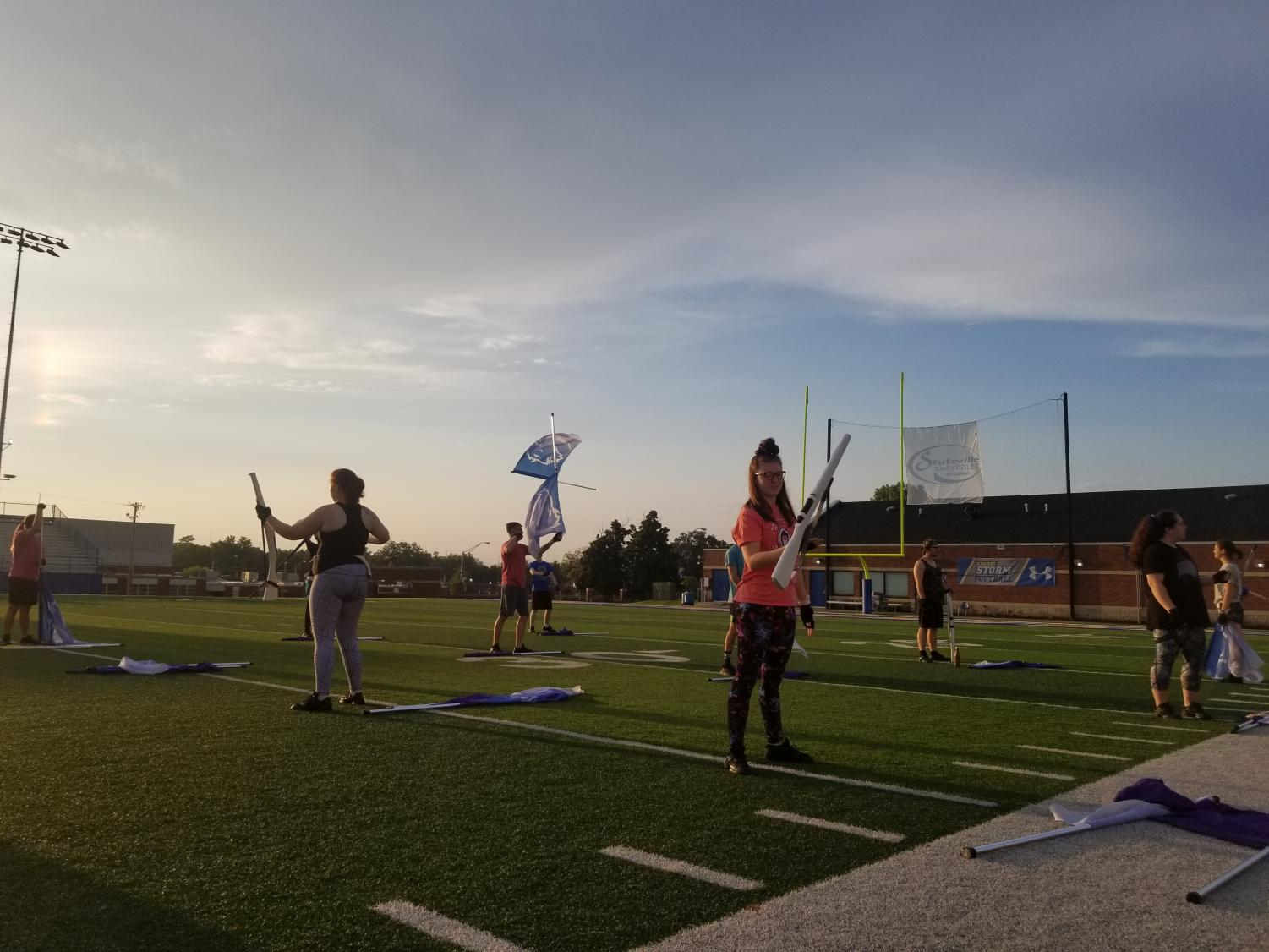 The Southeastern Band and Color Guard wakes up before the sun to begin morning practice every weekday from 7:30 a.m. to  9 a.m. Guard Members featured from left to right: Trey Wier, Lydia Finch, Nicholas Herfurth, Dalton Amiott, Destiny LaRue, Wesley Ridenhour, Katie Hester and Katie Thomas.