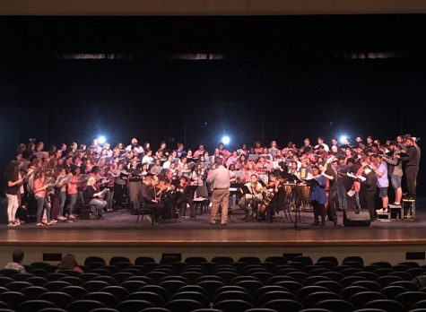 Choctaw High School, Del City High School and Rose State College join Southeastern Oklahoma State University on stage in rehearsal for the Oklahoma Classical Festival.