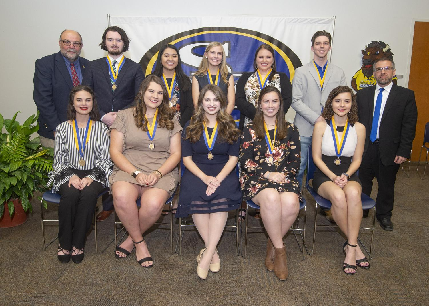 Front row, left to right, are Katie Thomas, Carli Wharton, Anna Alessia Antuono, Madelyn Bradberry, and Reagan Benson. Back row, Dr. Bryon Clark, Selby Stanton, Tammy Vo, Emily Dahl, Maegan Young, James Quarles, and Dr. Marlin Blankenship.