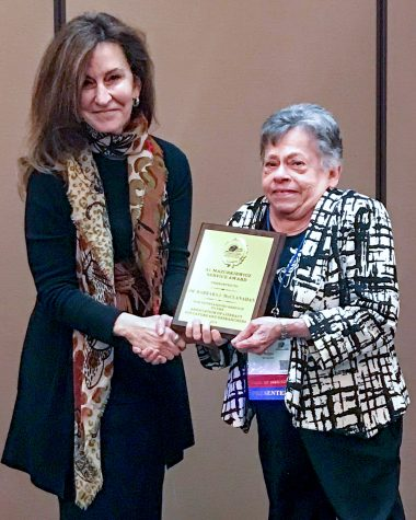 Dr. Tami Craft Al-Hazza, a past president of ALER, makes the award presentation to Dr. McClanahan.