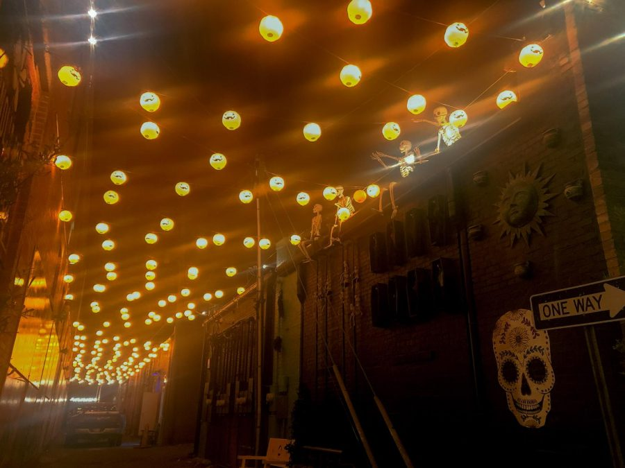 The Magnolia Mile Art Alley in Downtown Durant is lit with hanging pumpkin lanterns for the Halloween season.