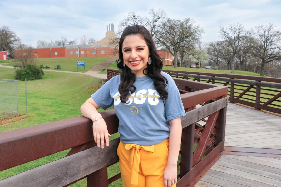 Yoselin Rodriguez-Diaz poses in front of the Biology Building where she spends most of her time working towards a career as a physician's assistant