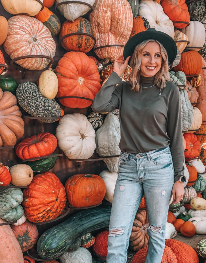 Madelyn Haines, an SE alumna, poses for a photo while enjoying time with family at the Dallas Arboretum and Botanical Garden on Sept. 28, 2020.