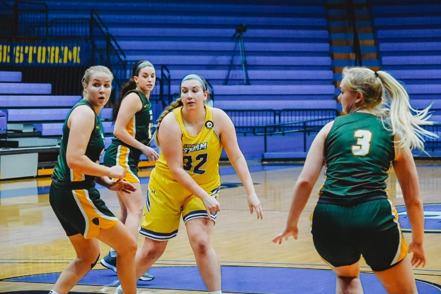 Katie Branam, senior chemistry major, surrounded by OBU players on Jan. 23.