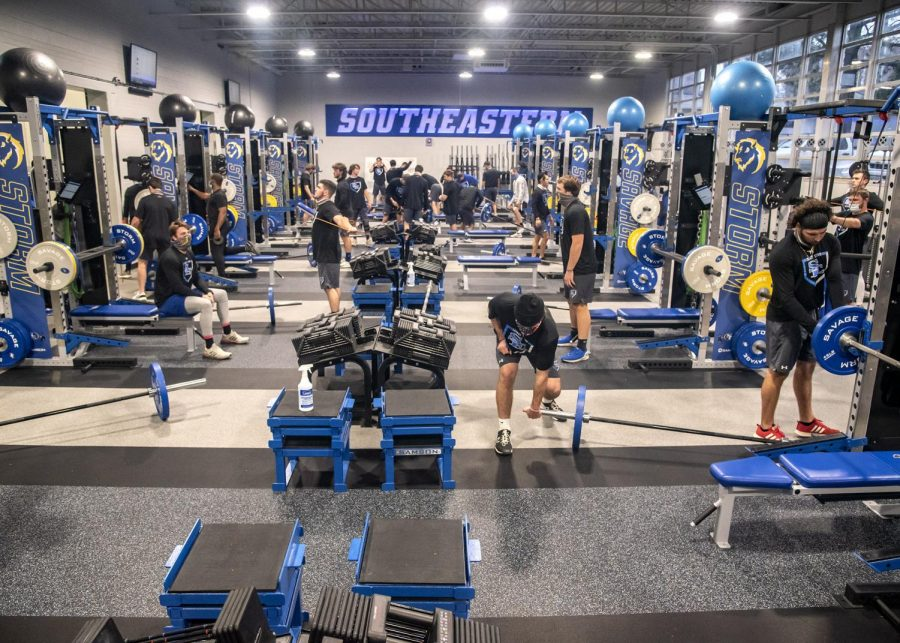 Athletes+work+out+in+the+new+weight+room.
