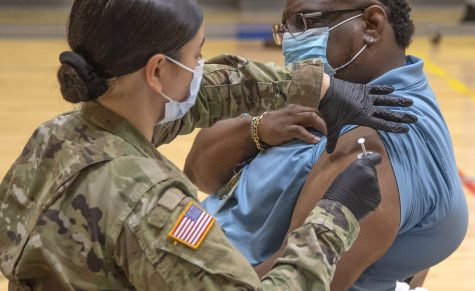 The Oklahoma National Guard assisted in the administering of vaccinations during each on-campus event. Dr. Fendrich R. Clark, Associate Professor and Speech and Debate Advisor for Southeastern, can be seen seconds before his own vaccination.