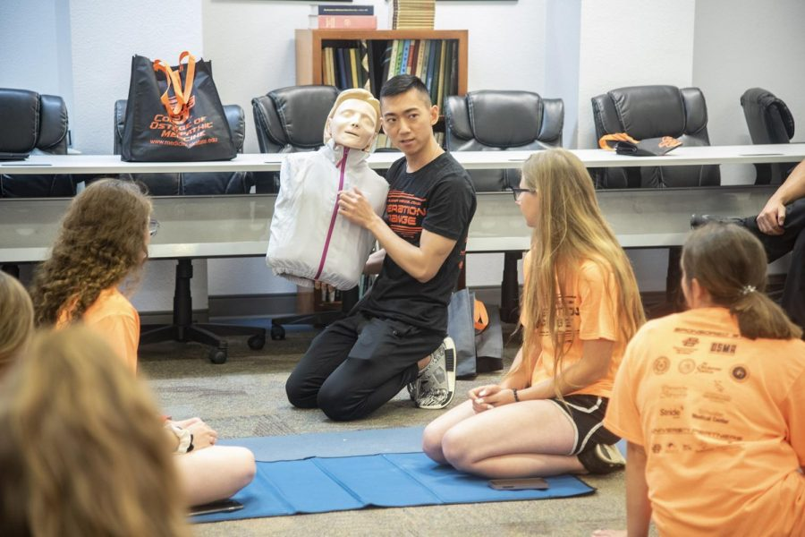 OSU medical student gives a  demonstration with a Rescue Annie CPR training mannequin.