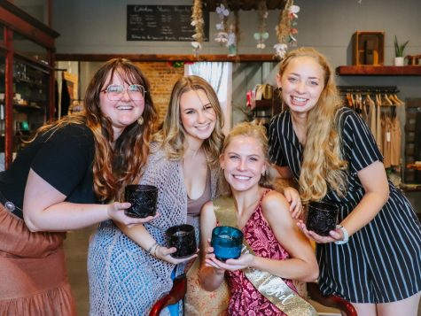 A group of students celebrating a birthday at U-We gifts by making candles. (Left to right: Loraine Thompson, Kylee Kuykendall, Emily Dahl and Madison Clark)